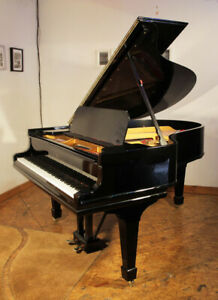 A rebuilt 1909 Steinway Model O grand piano with a black case and spade legs.