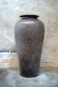 Monumental ceramic vase in classic design. Glaze in brown shades.