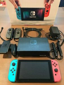 Nintendo Switch 32GB Console w Neon Red and Neon Blue Joy-Cons + EXTRA Joy-Cons