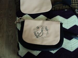 BLACK AND PINK CROSS BODY THIRTY ONE PURSE HAS CHANGEABLE FLAPS ONE EMBROIDERE