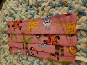 homemade face mask pink with monkeys and giraffes
