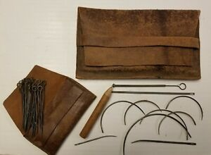 ANTIQUE LEATHER SEWING KIT. $25.00