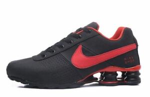 BRAND NEW MENS NIKE ATHLETIC SHOX DELIVER BLACK RED SIZES 7 11 $139.99