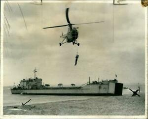 The Beach Master being hoisted by a winch into a he Vintage photograph 1921843