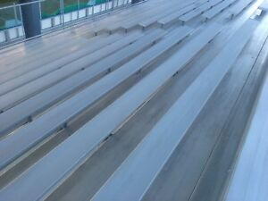 17 ROW ELEVATED ALUMINUM BLEACHERS WITH NEW FRONT DECK 1660 SEATS