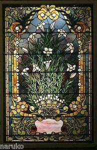 BONHAM'S AUTHENTICATED THIS  FLORAL STAINED GLASS WINDOW .