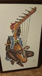 Signed painting of African man playing a string instrument