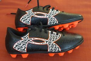 UNDER ARMOUR CF FORCE 2.0 CLEAT BLACK AND ORANGE ATHLETIC SHOES FOR YOUTH SIZE 5