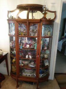 0OAK ANTIQUE CHINA CABINET WITH LEADED AND ROUNDED GLASS over 6 feet tall1880's