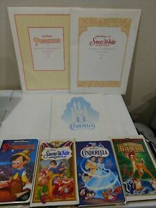 4 VHS Disney Classics With Lithographs for Snow White Pinocchio