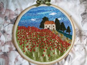 Handmade craft, needle thread landscape on canvas rings to hang on the wall.