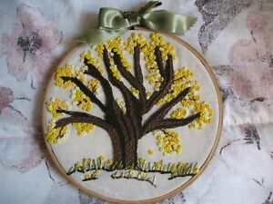 Handmade craft, needle thread trees on canvas rings to hang on the wall