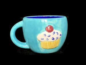 Kids Pottery Mug With Relief Cupcakes A 01