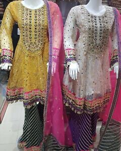 Pakistani And Indain Wedding Dresses Yellow And White Dresses..