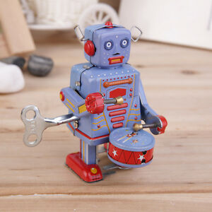 vintage metal tin drumming robot clockwork