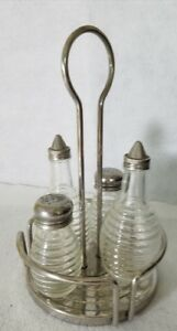 Condiment set stainless and glass oil vinigar salt pepper and caddy