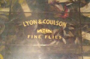 Old vintage Lyon Coulson fly fishing box with dozens of new fly flies dry