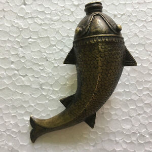 An old or antique solid brass powder flask mughal style fish shaped