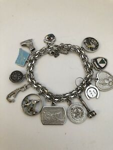 VINTAGE STERLING SILVER 7.25 INCHES  CHARM BRACELET 14 CHARMS WELLS ETC