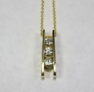 14K Yellow Gold 3 Round White Floating Diamond Pendant .57 Carats With Chain