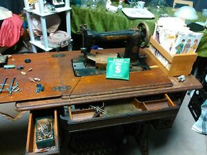 Antique Singer Machine and cabinet $490.00