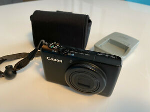 Canon PowerShot S95 10 MP Digital Camera + Battery + Charger + Case + 32 gb Card