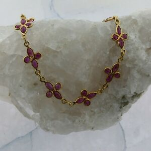 14K Yellow gold Ruby Bracelet 11 Rosettes of 4 Stones 7.25 Inch Long Circa 1970