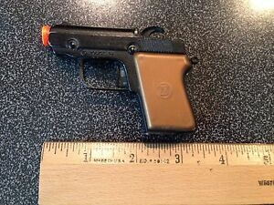 miniature police model 45 cap gun toy made by rare