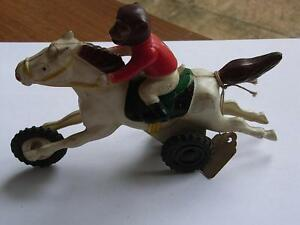 vintage s friction race horse with monkey