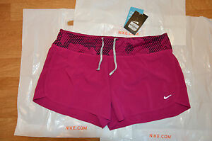 bnwt women's Nike fuchsia running shorts with back pockets size L