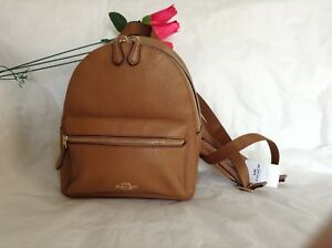 NWT. Coach Pebbled Leather Mini Charlie Backpack Bag Light Saddle F28995