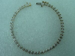 10K Yellow Gold Diamond Wavy Starburst Link Tennis Bracelet 7
