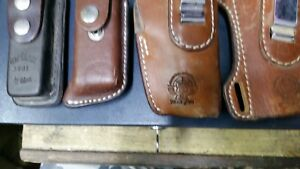 lot 2 9mm leather holsters and 2 magazine leather pouches used fobus