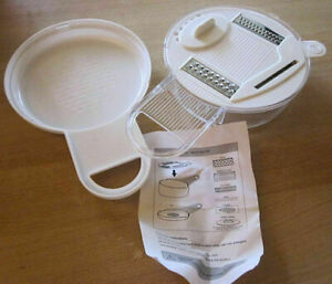 White plastic 5 in 1 multi-grater with instructions