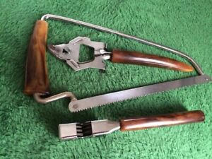 Vintage BAKELITE Meat Saw-Bottle Opener-Pull Through Knife Sharpener
