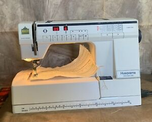 VIKING HUSQVARNA PRISMA 945 SEWING MACHINE WITH CASE AND FOOT PEDAL $200.00