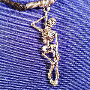 Hanging skeleton pendant on black wax cord necklace