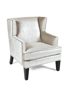 Loni M designs small wing chair  trim and the lush polished velvet fabric