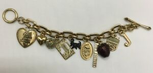 Juicy Couture Gold Tone charm bracelet with 10 charms