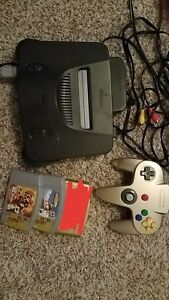 Nintendo 64 console with GOLD controller and 2 games
