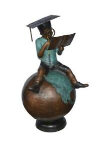 Student learning on top of world bronze statue -  Size: 28