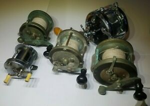 FIVE 5 VINTAGE FISHING REELS: PFLUEGER 2 PENNELL PENN AND SOUTH BEND