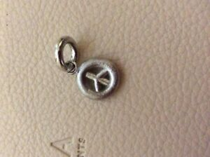 Story sterling silver PEACE charm GBP 6.00