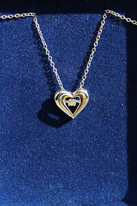 Heart pendent with floating diamond necklace
