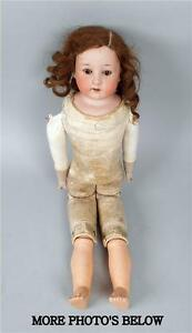 22 bisque socket head doll with leather body