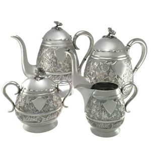 4 piece 905 Silver Antique Repousse Floral Design Tea Set
