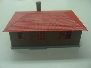 HO Built Modern Home With Red Tile Roof