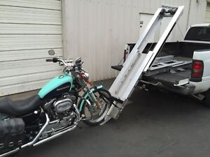 MOTORCYCLE LOADING AND LIFT SYSTEMS FOR ALL TRUCKS & RV'S