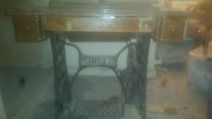Antique Singer wood needs restored but everything else is in good condition $260.00