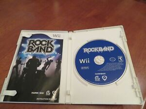 Lot of 7 Wii Video Games: RockbandGuitar Hero 3Lego Star Wars and more